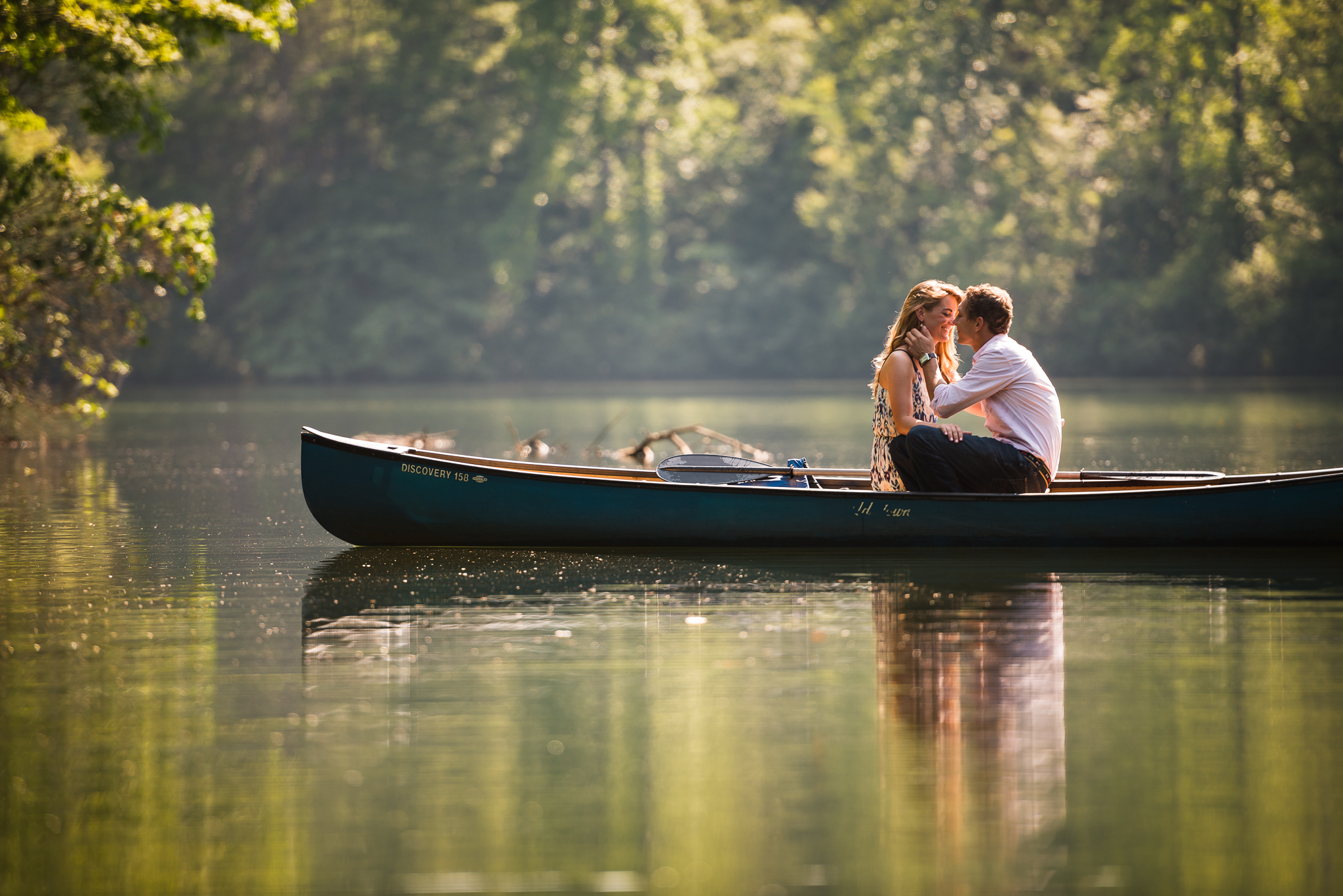 Canoe in lake engagement photos