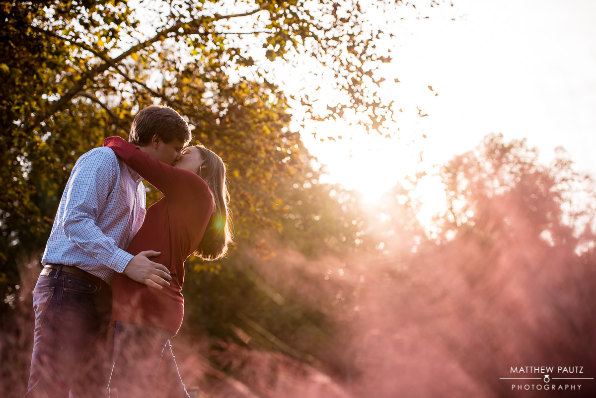Couple kissing at sunset in Falls park