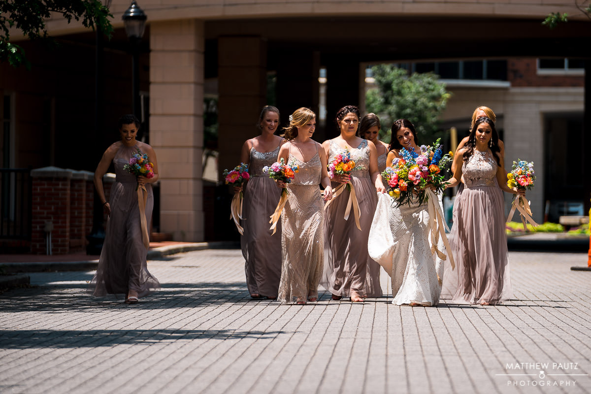 bridesmaids walking in a group in downtown greenville