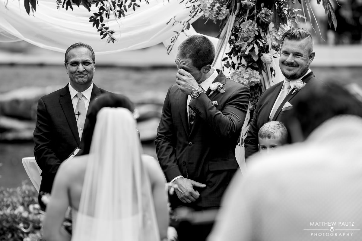groom crying while seeing bride for first time