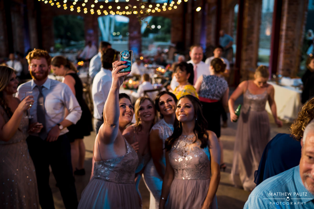 bridesmaids posing for a selfie during reception