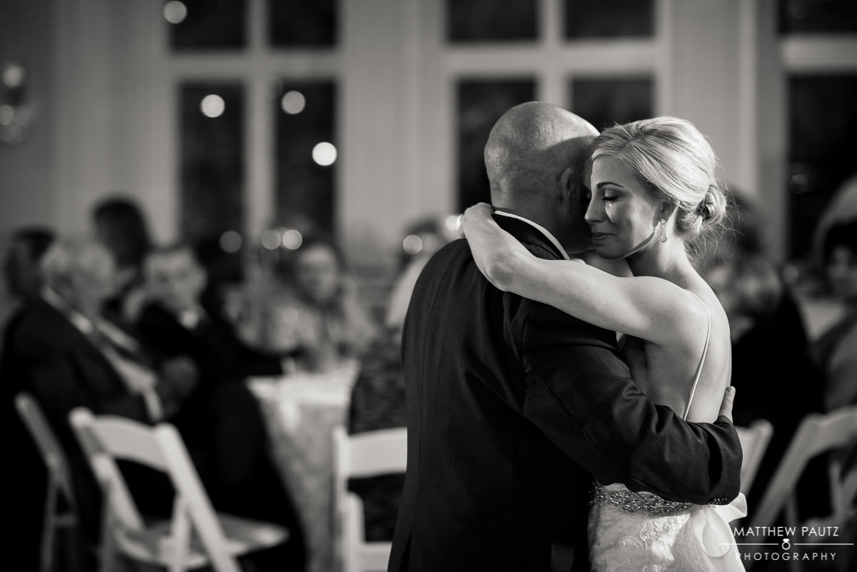 bride crying while dancing with father