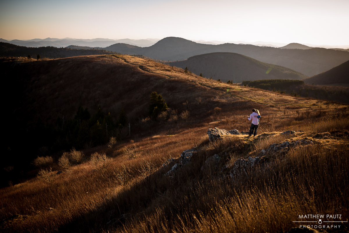 Mountain engagement photographer | engaged couple dancing on mountaintop