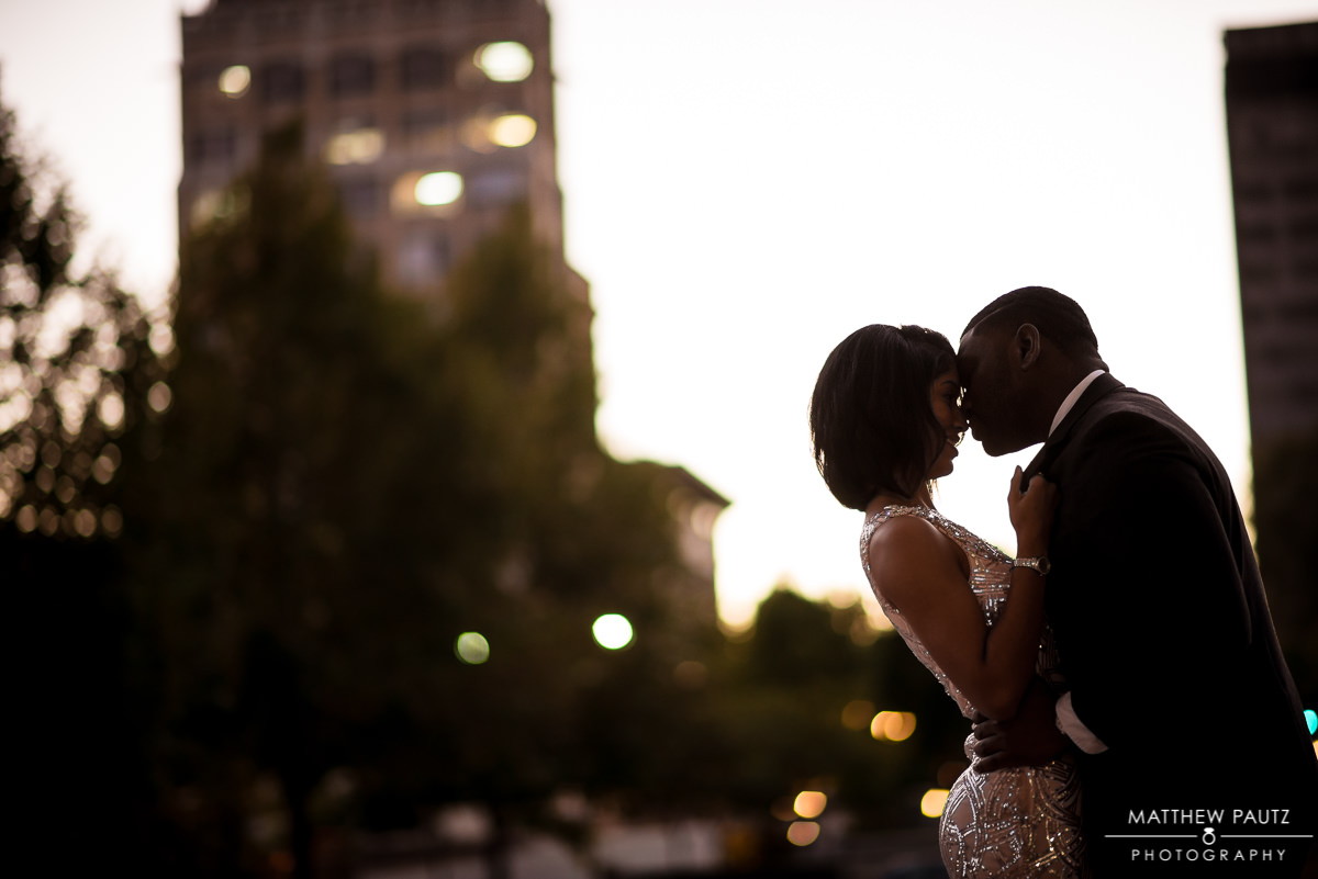 Asheville wedding photographer | Couple embracing in downtown Asheville NC