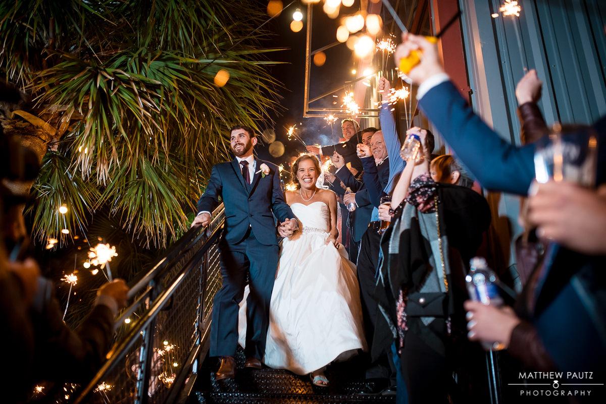 Bride and groom exit reception
