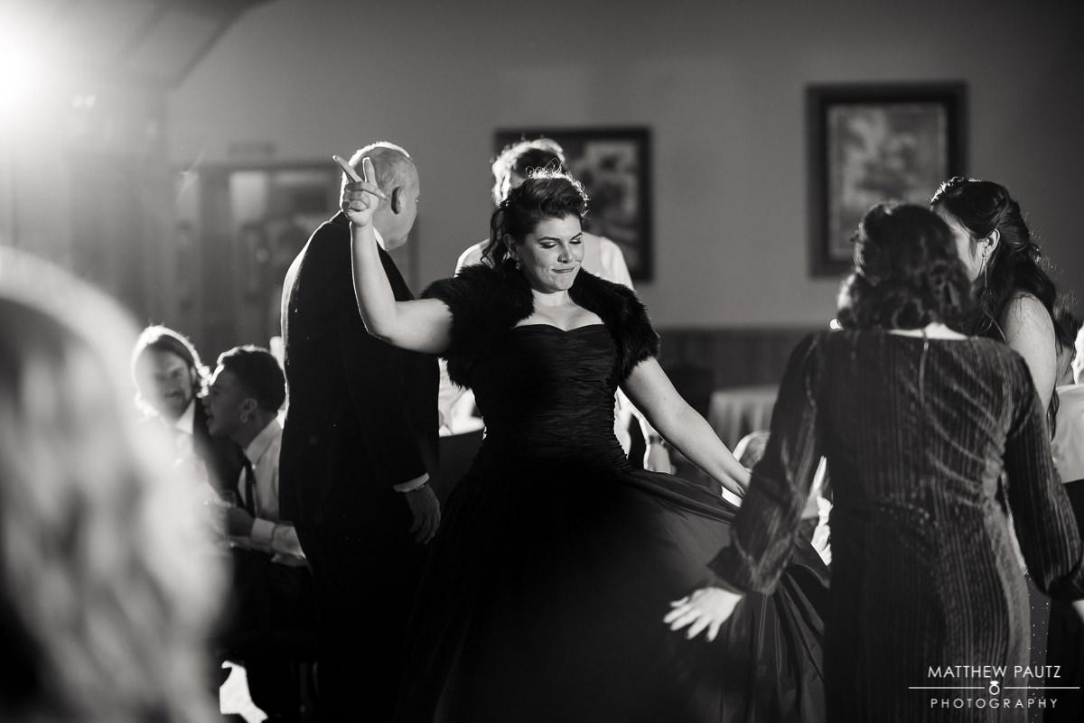 Crest Center wedding reception photos | bride in black dress dancing