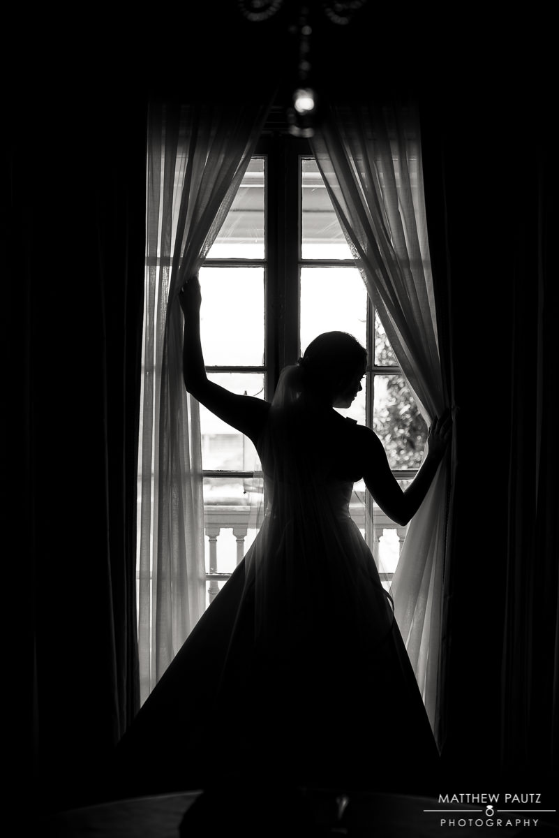 silhouette of bride in the window at the poinsett club in Greenville sc
