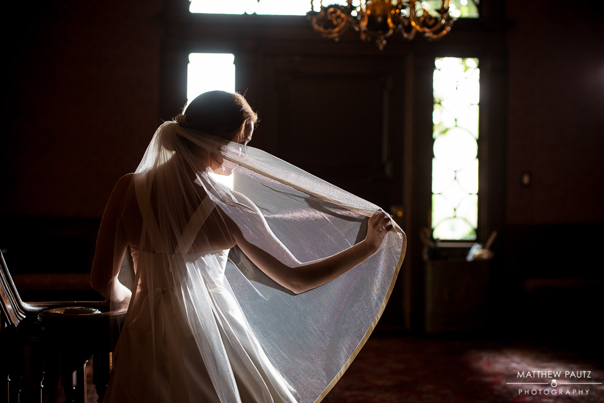 bride adjusting her veil at the poinsett club