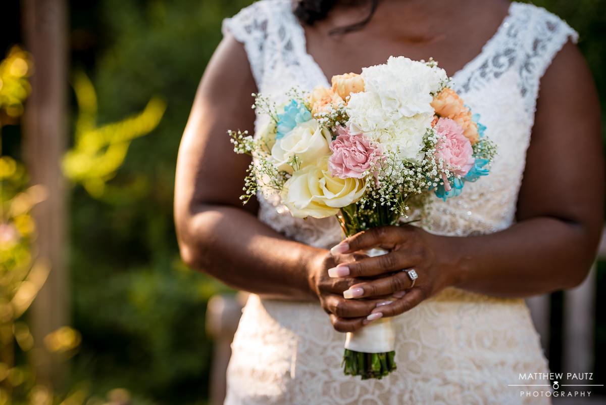 Closeup of bride holding bouquet