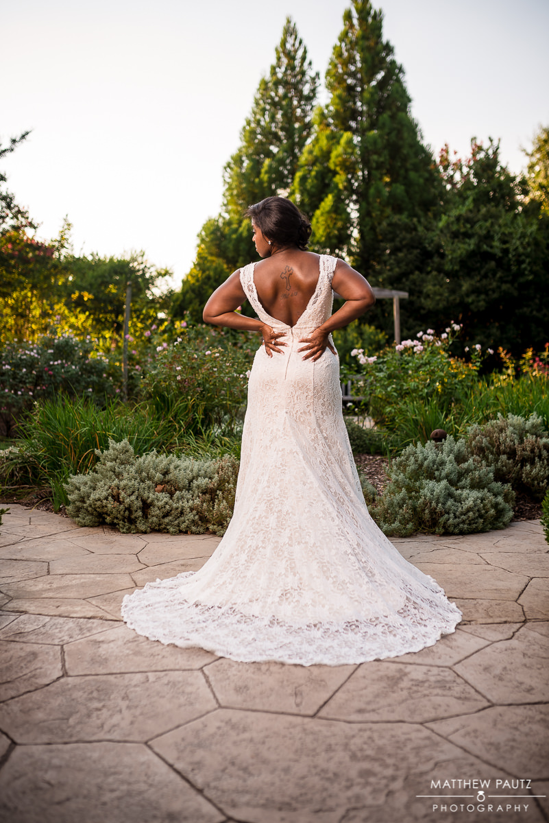Bride looking away over botanical gardens
