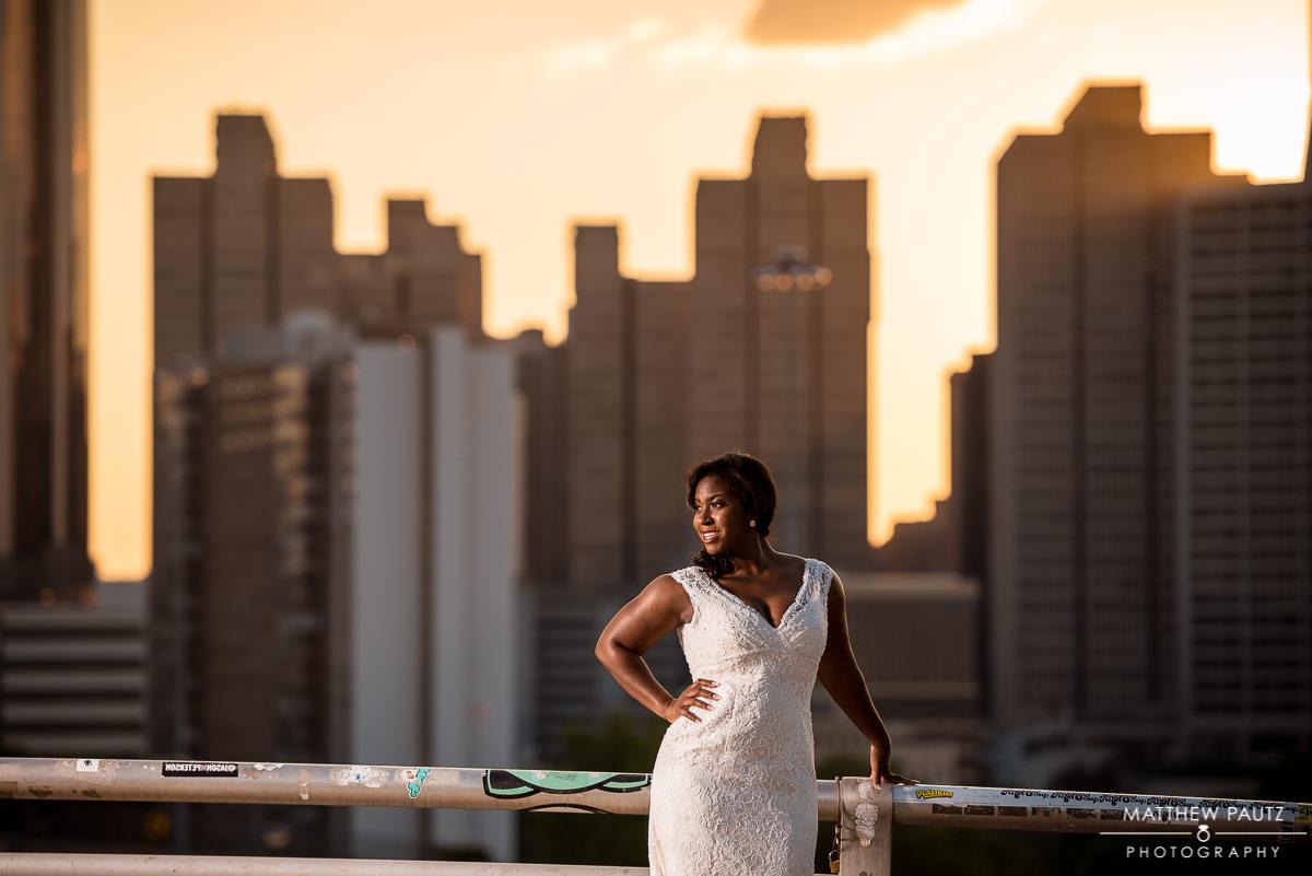 Smiling bride overlooking downtown atlanta