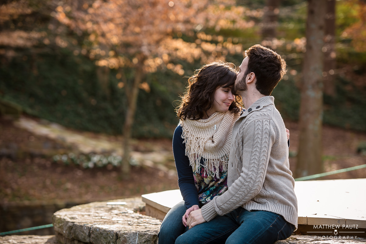 Engaged couple kissing in Falls Park