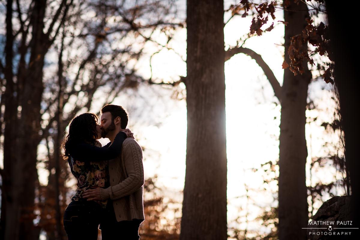 Falls Park engagement photos | engaged couple kissing