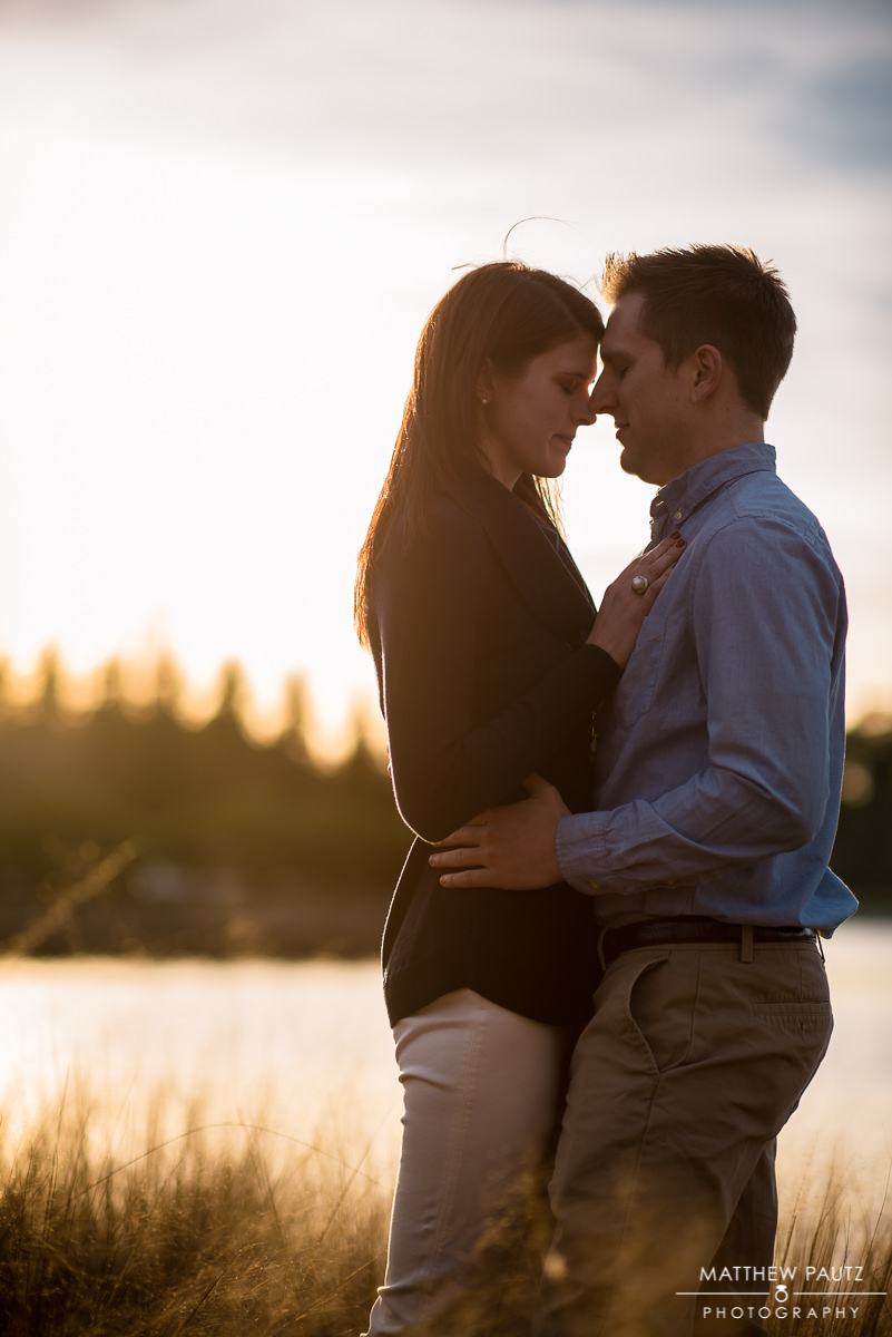 couple holding each other close at sunset