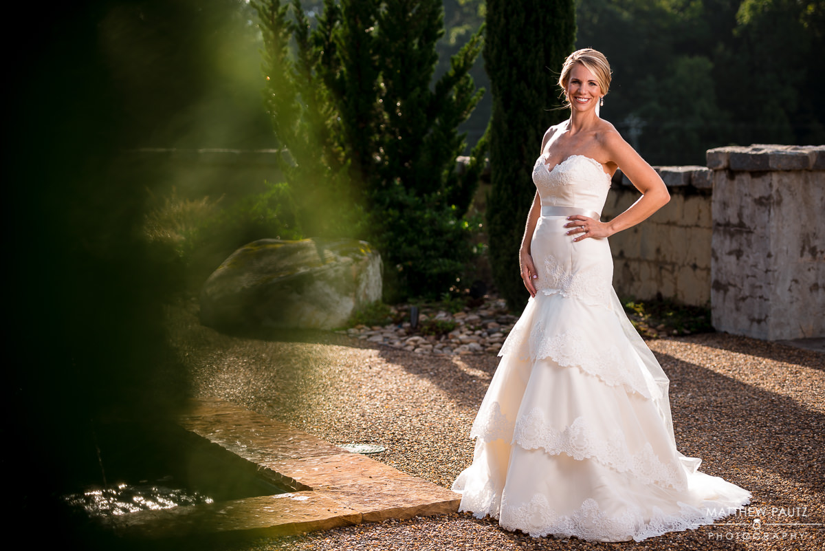 bride in dress smiling in garden