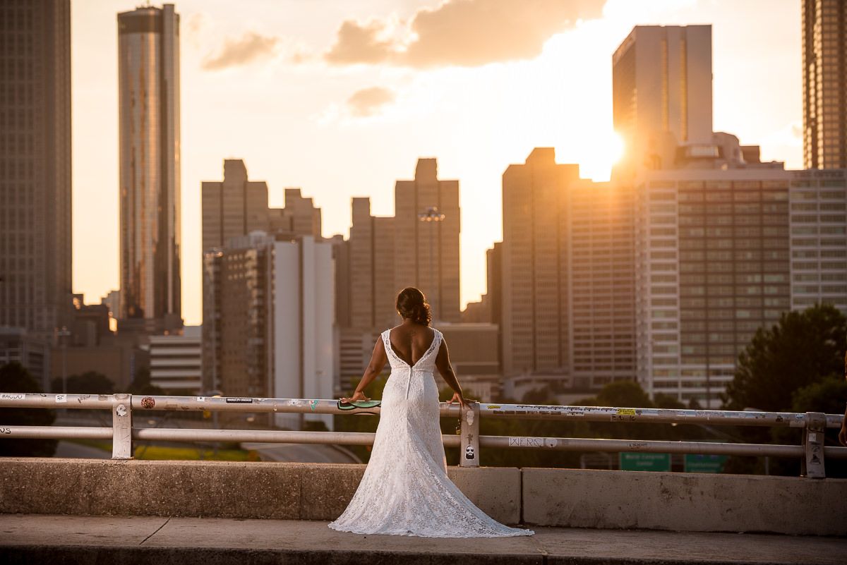 Bride overlooking beautiful sunset overlooking downtown atlanta skyline