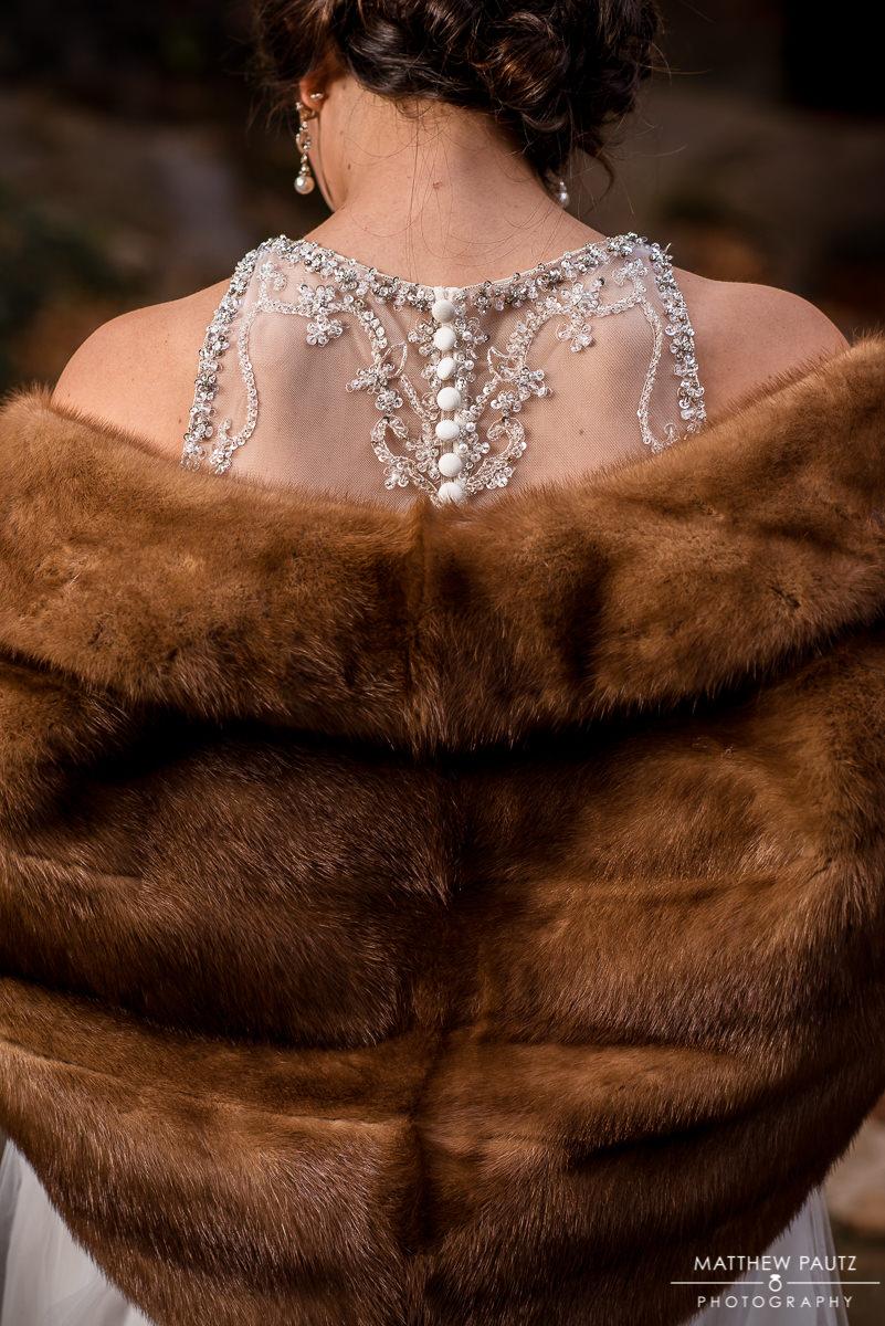 Bride wearing fur wrap