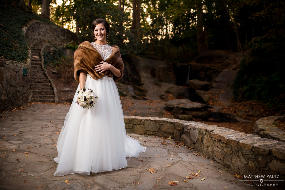 Bride holding flowers and wearing a fur wrap in Fall