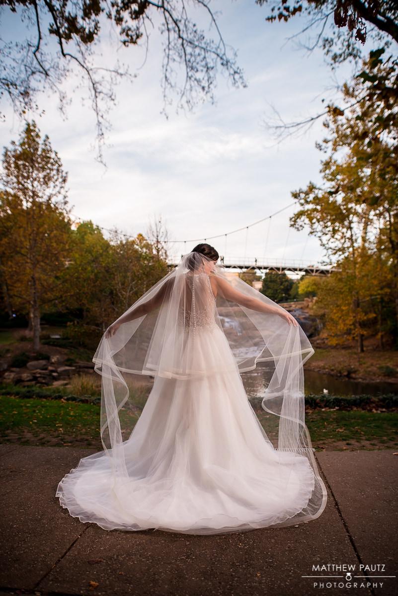 bride adjusting her veil in Falls Park