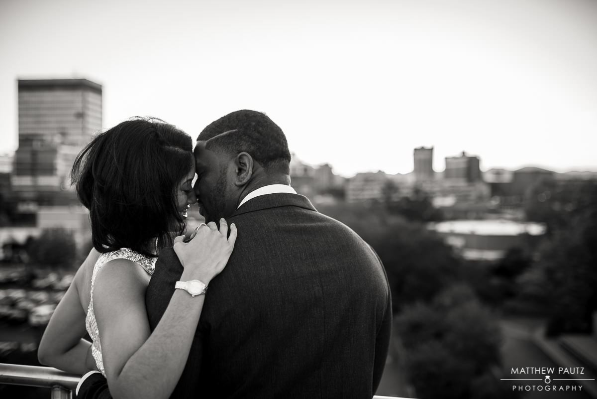 engaged couple kissing overlooking asheville NC