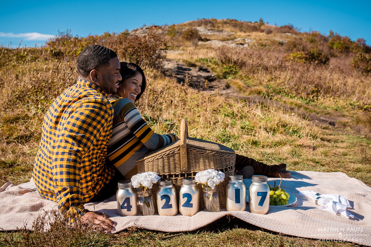 Engaged couple picnicing in the mountains