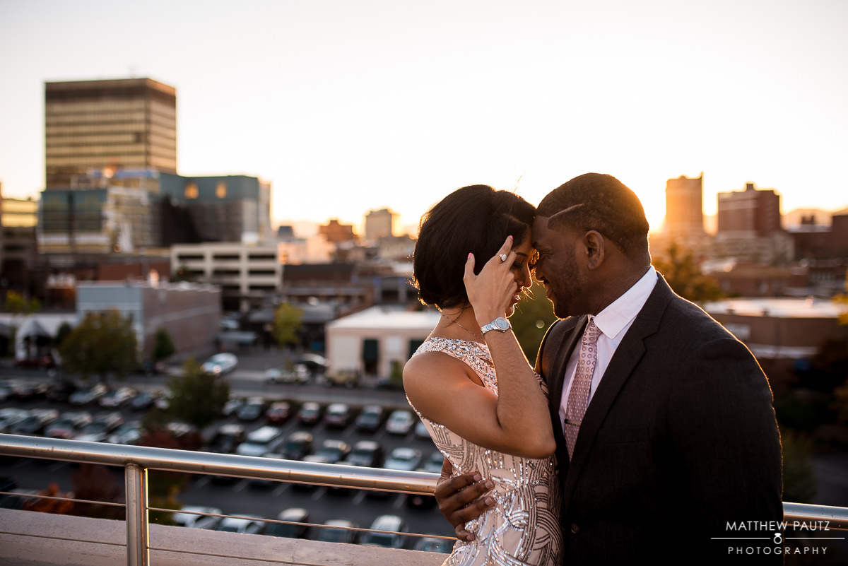Engaged couple hugging overlooking downtown Asheville NC