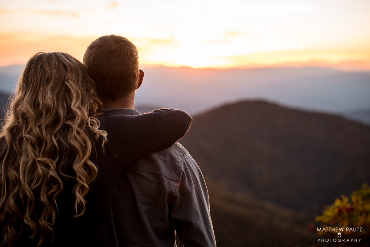couple in mountains looking out over the blue ridge mountains