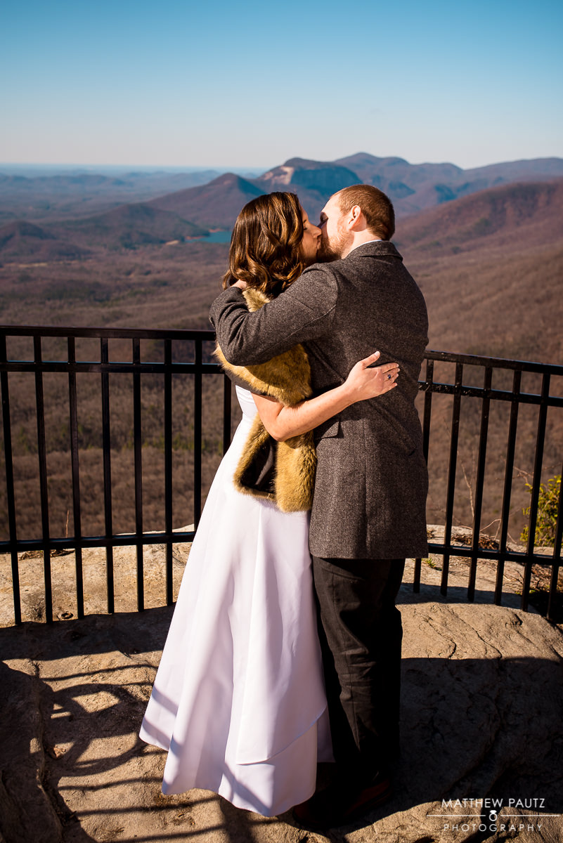 eloping couple's first kiss at caesar's head overlook