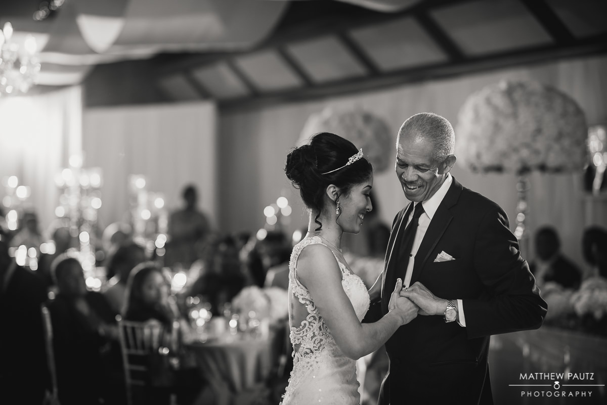 bride dancing with father at wedding reception