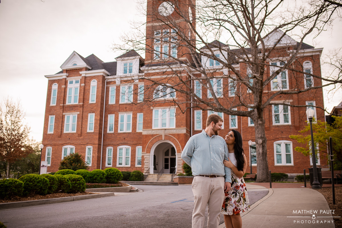 engaged couple posing in front of Tillman Hall