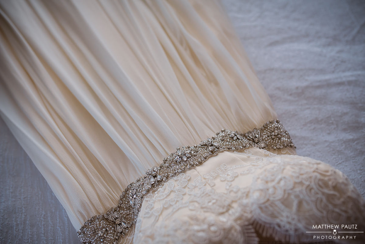 Closeup of details of wedding dress