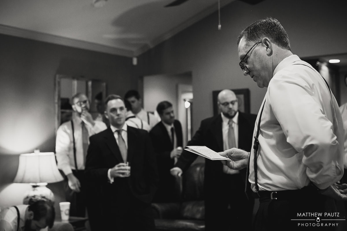 Father of the Groom reading letter before wedding