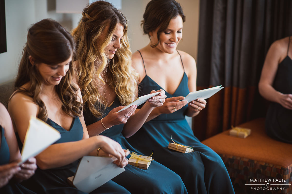 Bridesmaids before wedding reading letters