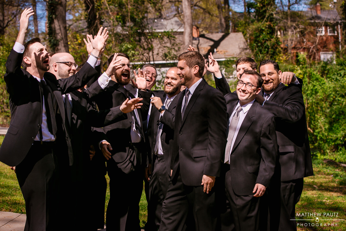 Groomsmen laughing and having fun before wedding