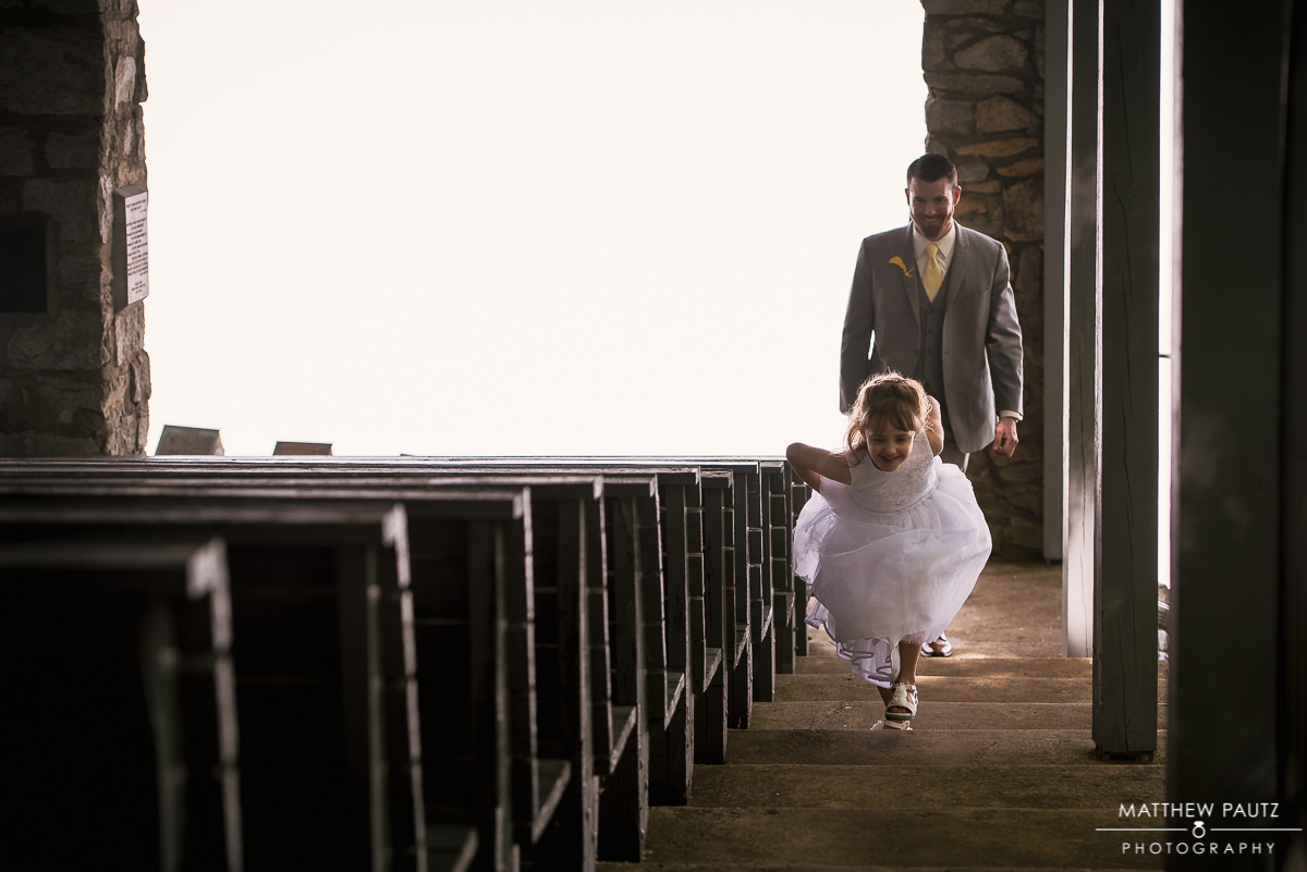 flower girl running up stairs at Pretty Place Chapel