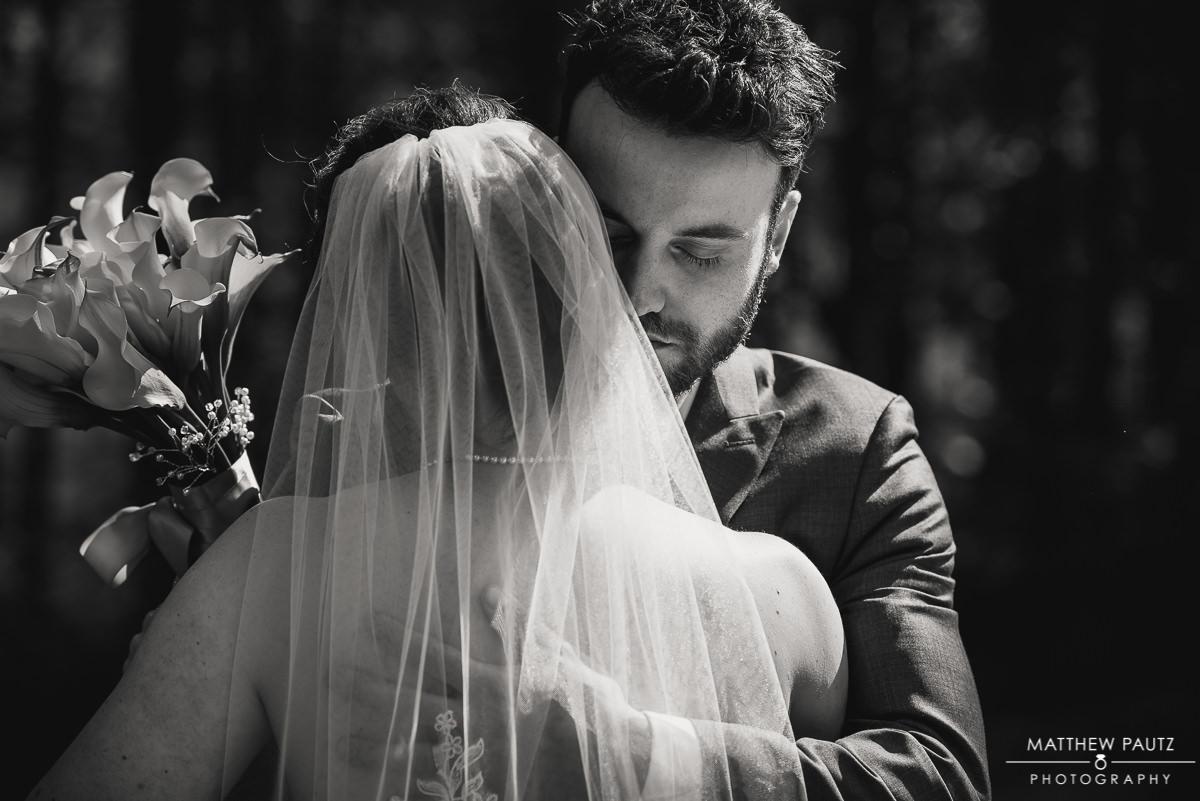 Bride and groom hugging after ceremony