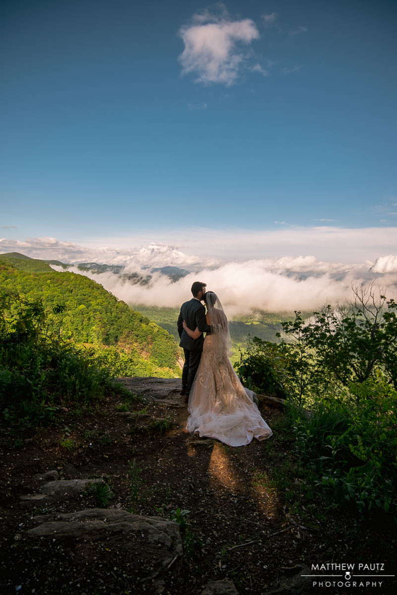 Bride and groom overlooking mountain view at Pretty Place Chapel