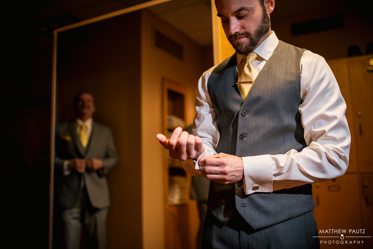 Groom getting ready for wedding at Green Valley Country Club