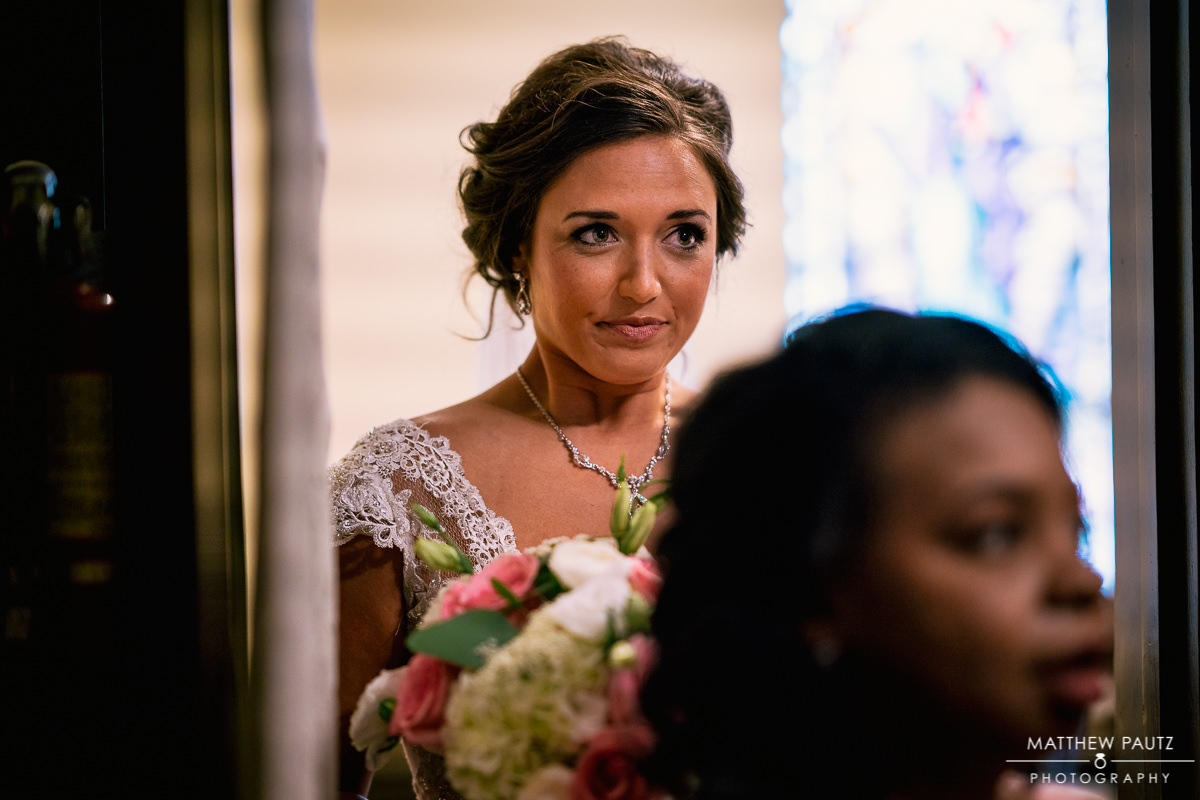 bride looking thoughtful before wedding ceremony at st mary's catholic church