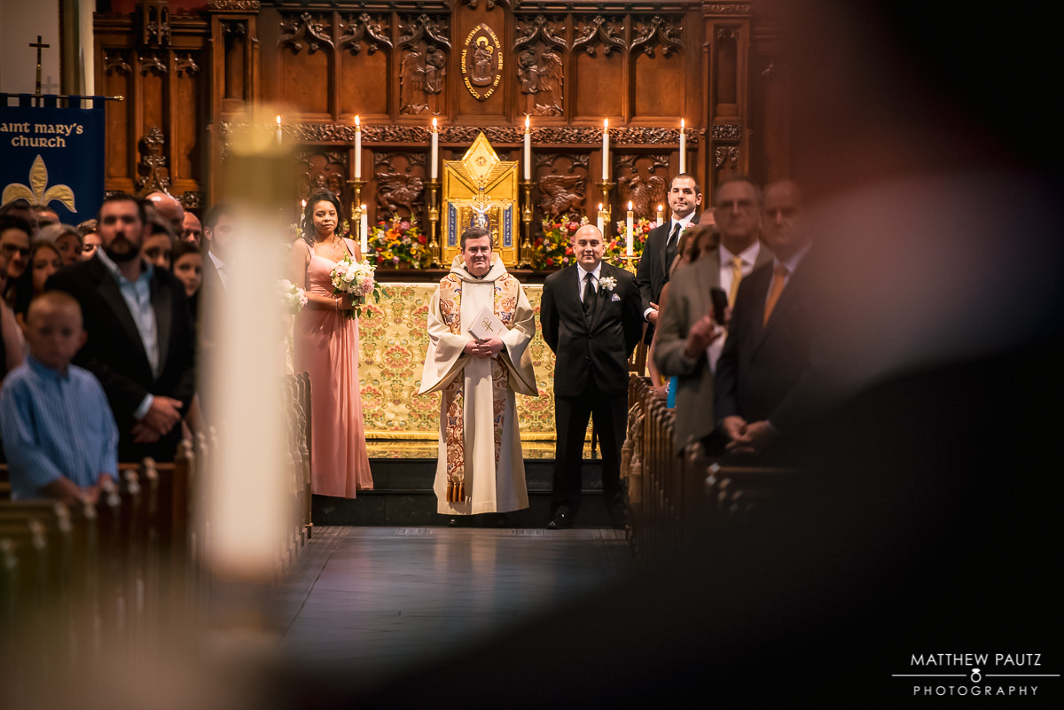 groom sees bride for the first time at St Mary's catholic church