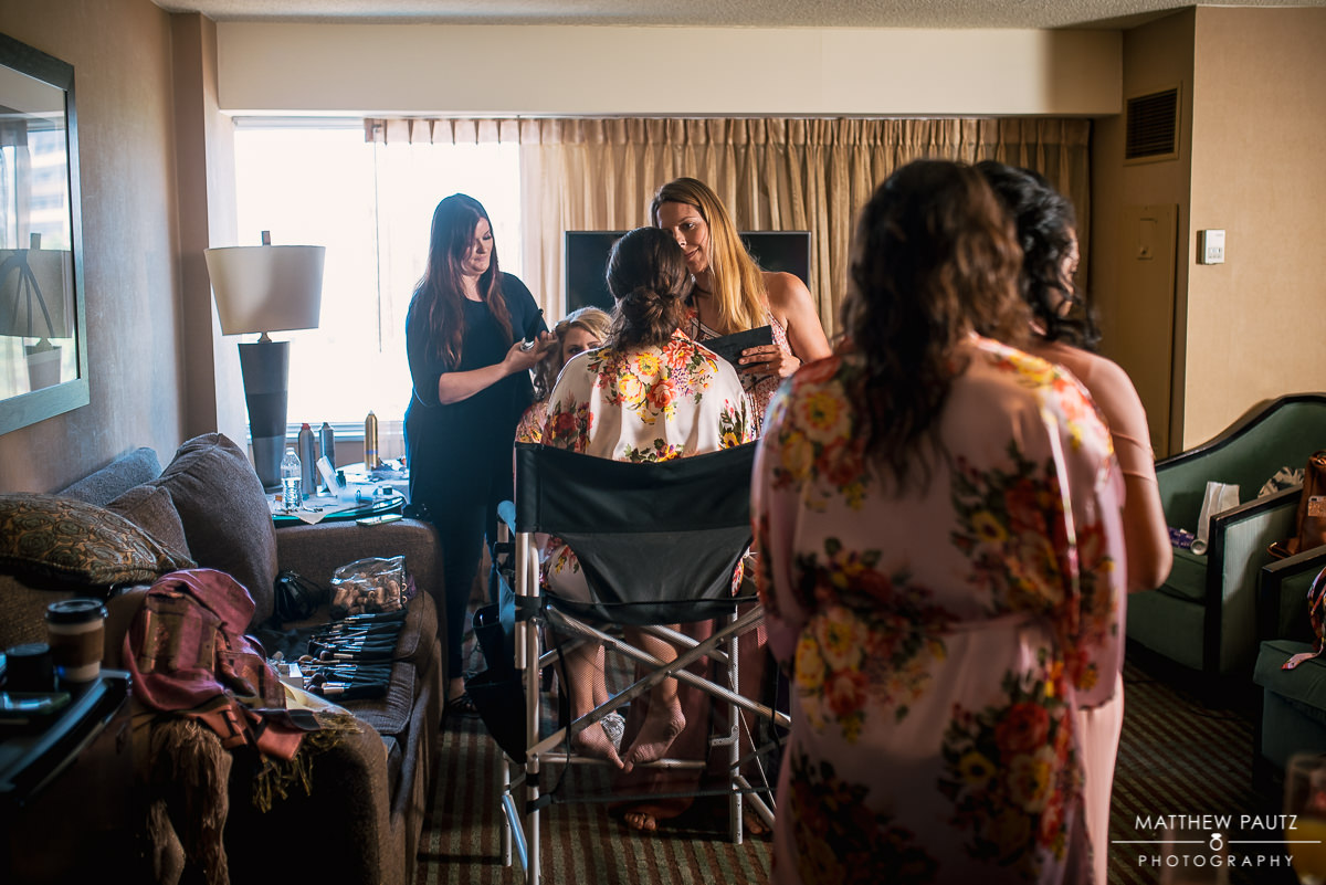 bridesmaids getting hair and makeup done at The Hyatt, Greenville
