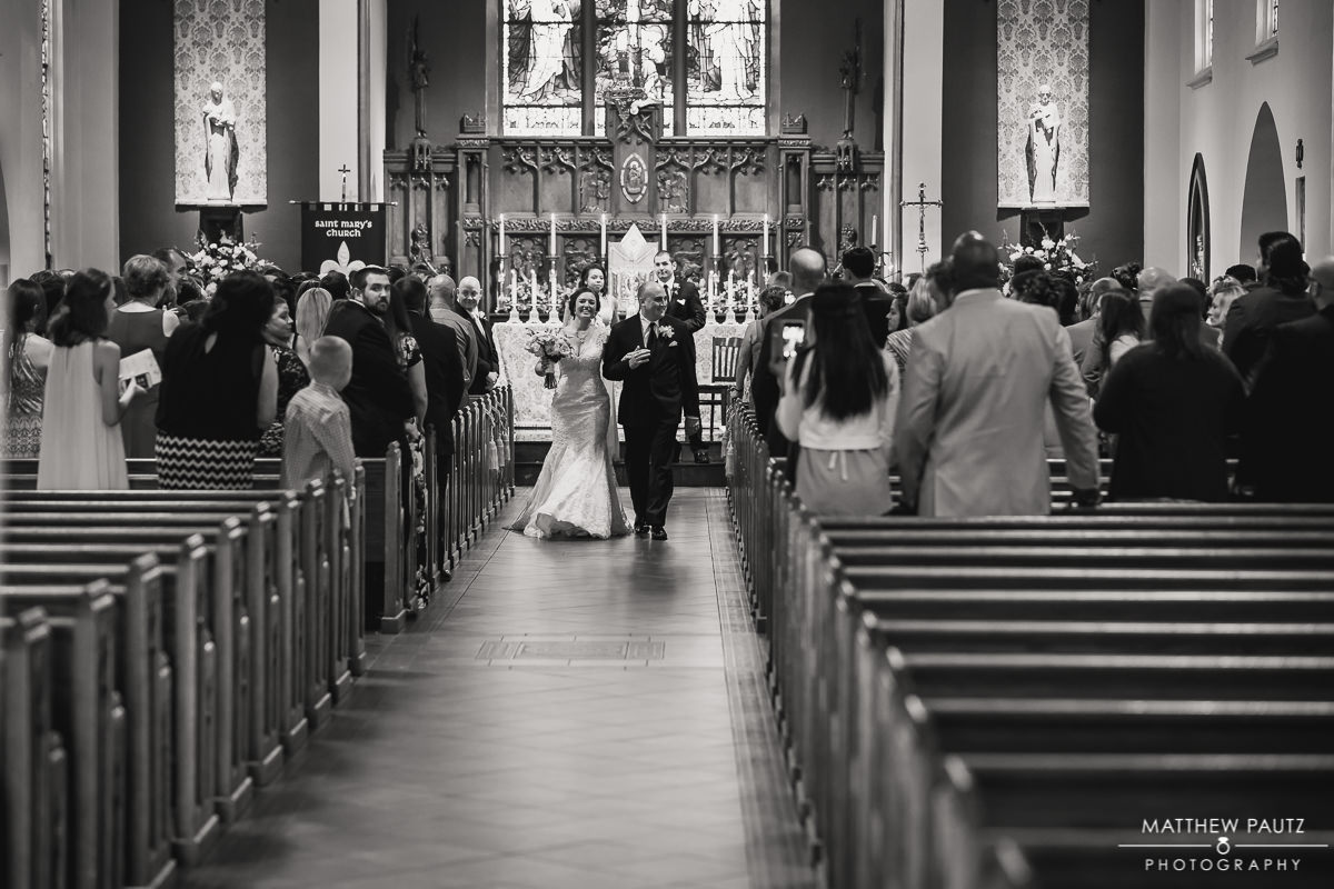 bride and groom leaving church wedding ceremony