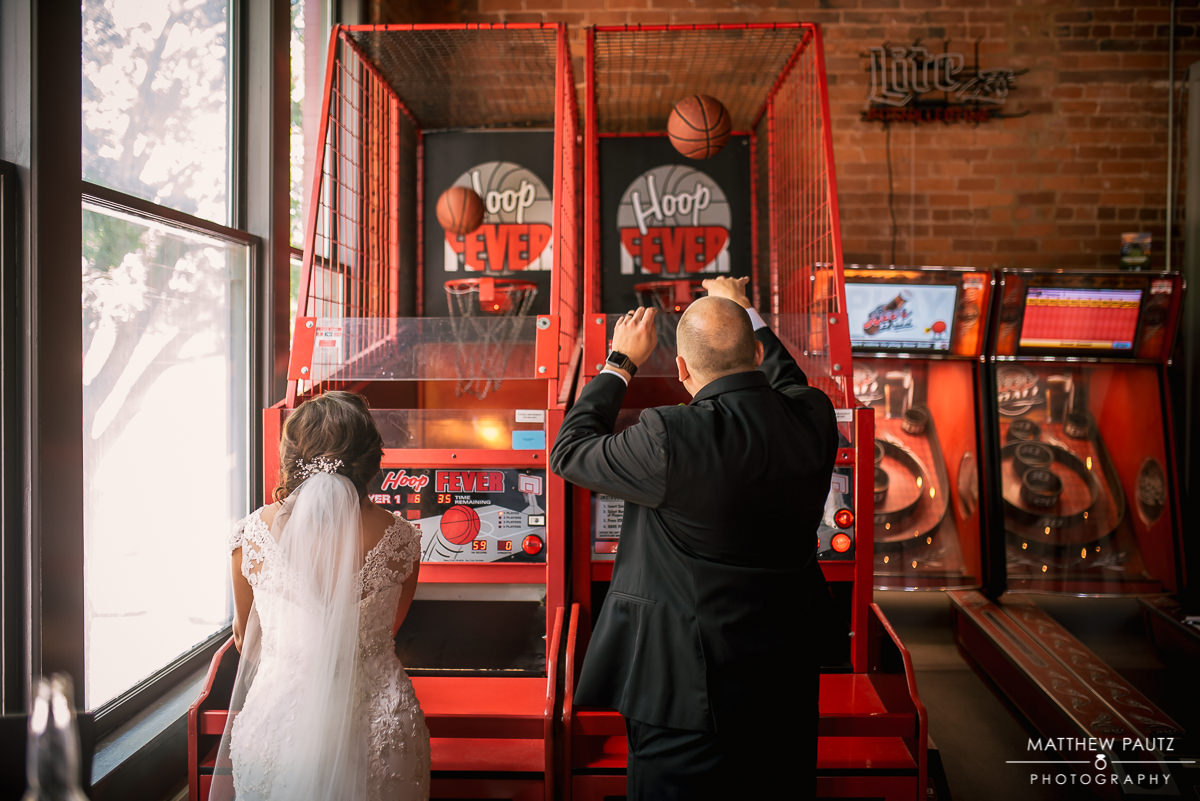 bride and groom playing basketball game at Brazwell's pub, greenville sc