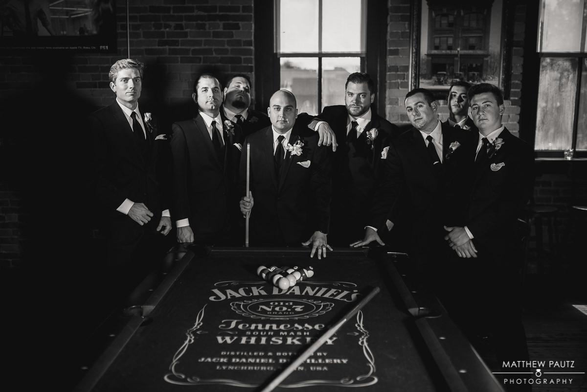 groomsmen group photo around pool table