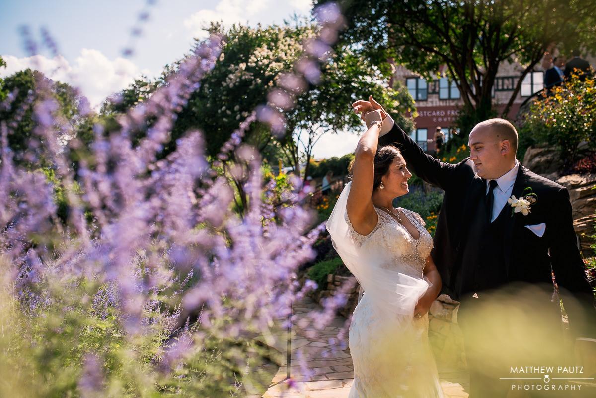 bride and groom dancing in Falls Park, Greenville sc