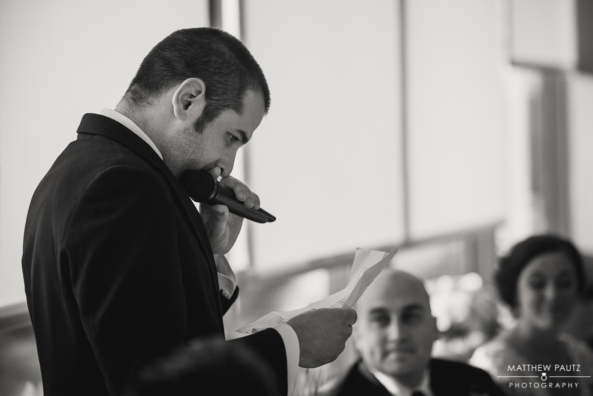 best man giving emotion speech at wedding reception