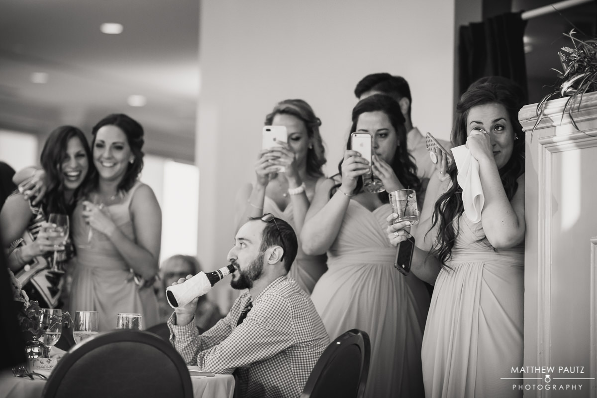 emotional bridesmaids watching first dances at reception