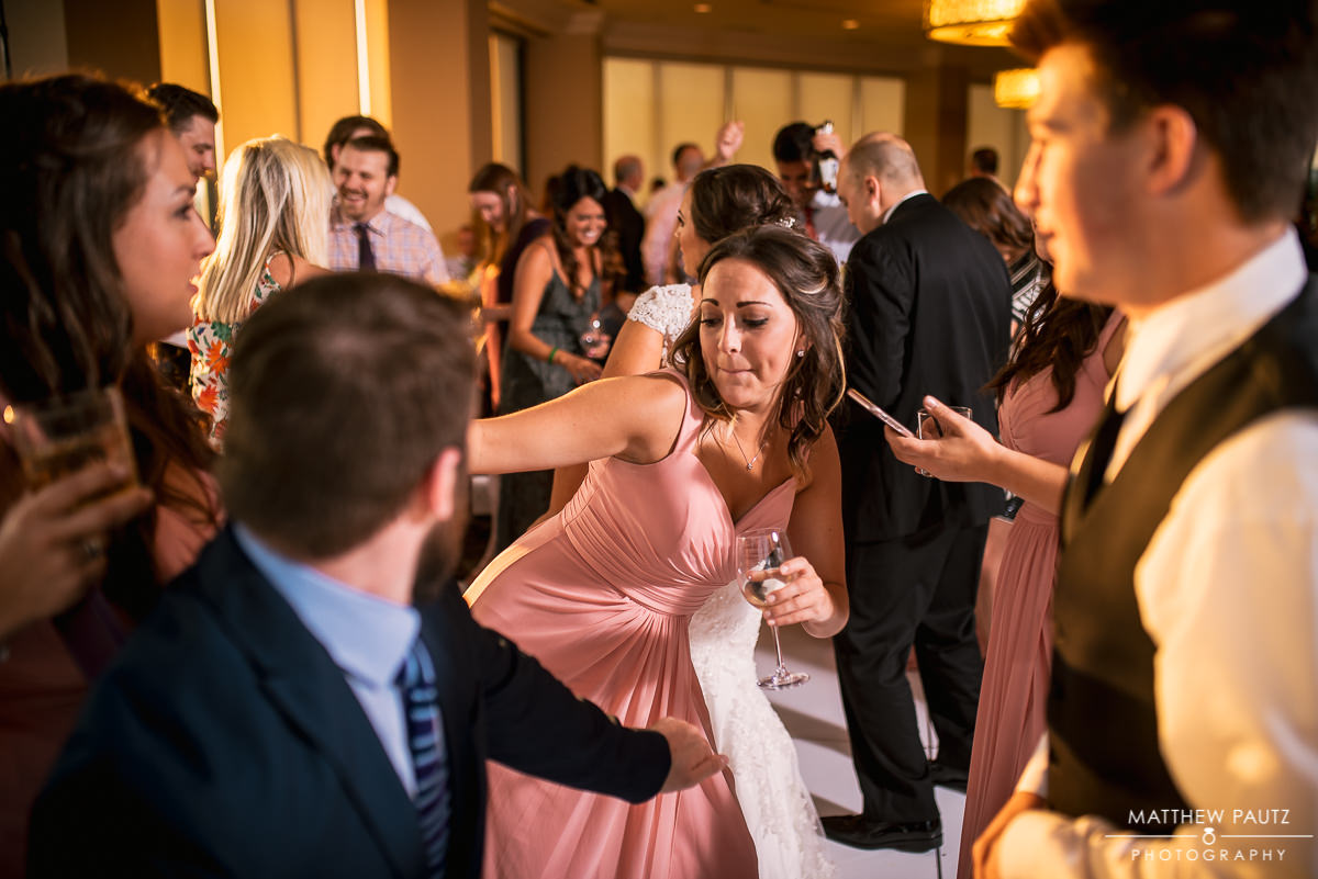 bridesmaid having fun and dancing at commerce club reception