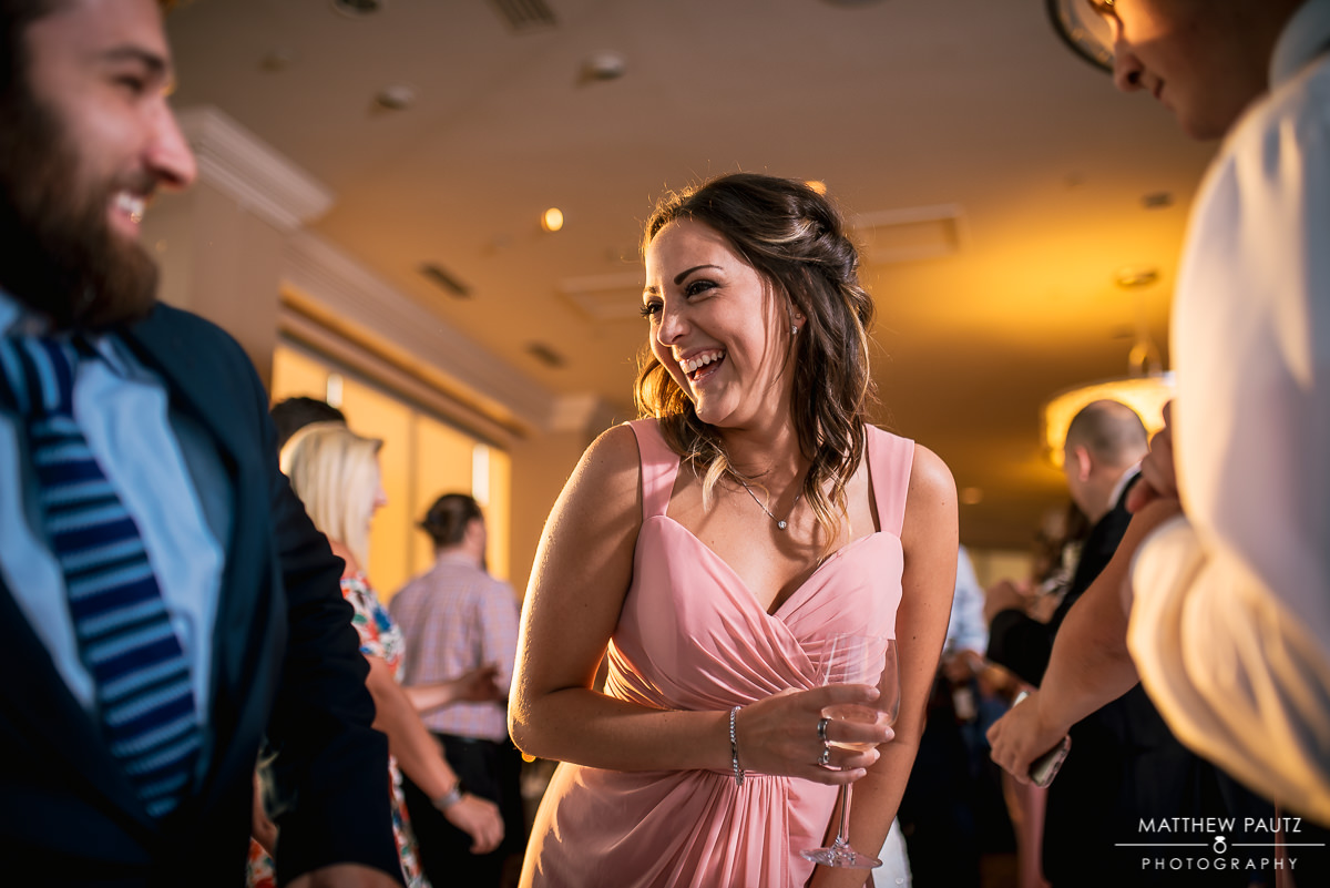 bridesmaid laughing on dance floor
