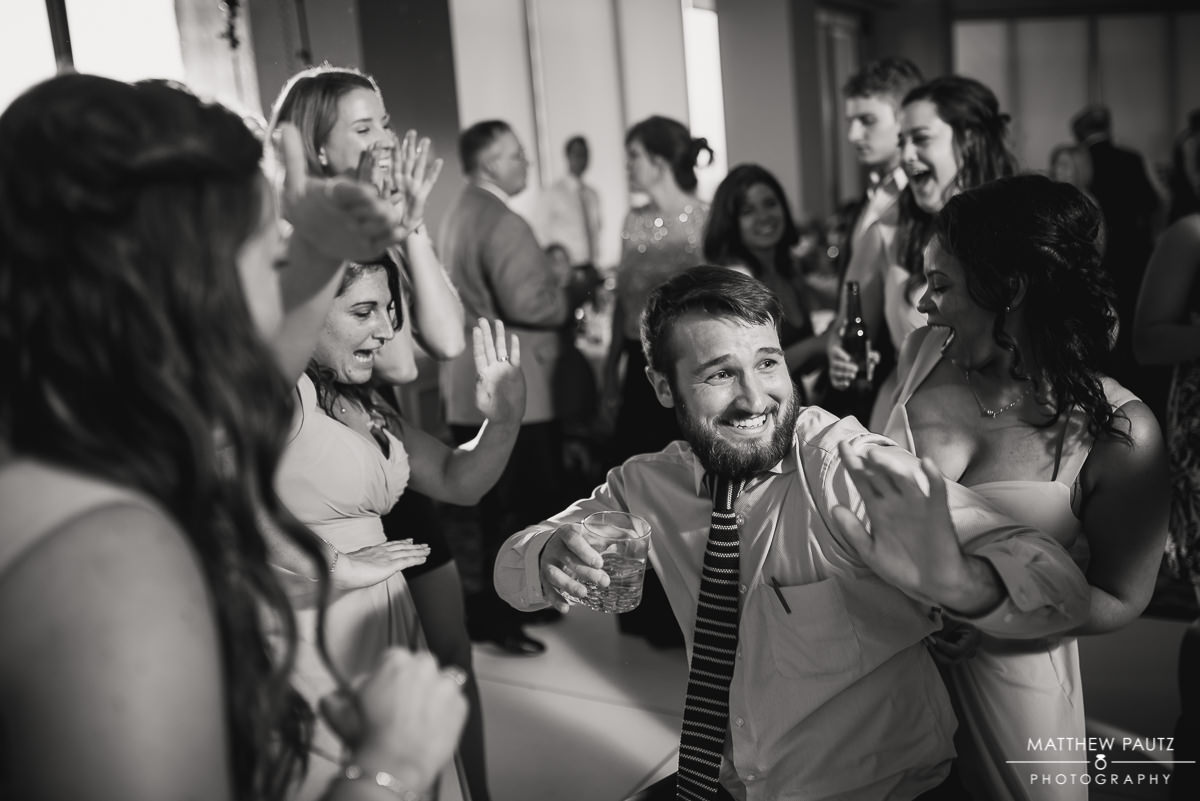 wedding guest having fun and dancing at wedding reception